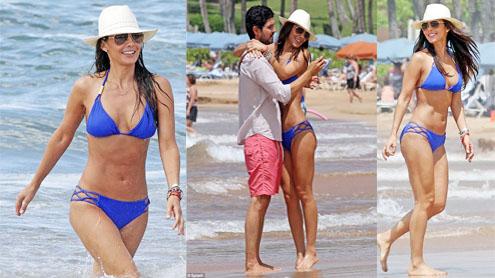 Ali Landry parades her six-pack in blue bikini