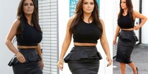 Kim Kardashian bursts over the waistline in a too-tight leather peplum skirt