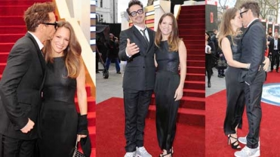 Robert Downey Jr passionately kisses his wife at Iron Man 3 premiere