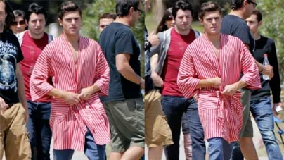 Zac Efron reveals his super toned chest in a striped robe